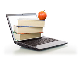 Laptop with books in the screen and an apple on top